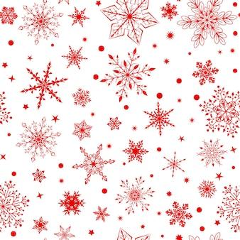 Padrão sem emenda de natal com vários flocos de neve complexos grandes e pequenos, vermelhos sobre fundo branco