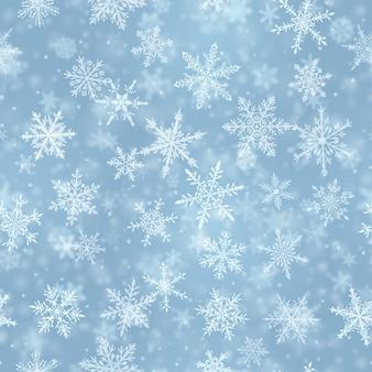 Padrão sem emenda de natal de complexos flocos de neve caindo nítidos e desfocados em cores azuis claras com efeito bokeh