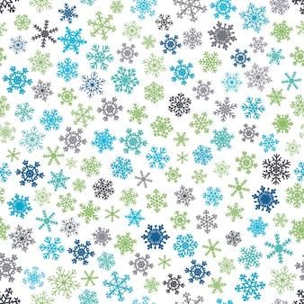 Padrão sem emenda de natal de flocos de neve, azuis e verdes sobre fundo branco.