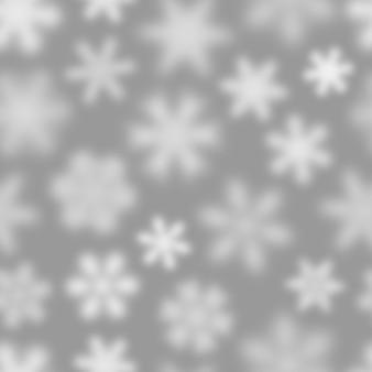 Padrão sem emenda de natal de flocos de neve brancos desfocados em fundo cinza
