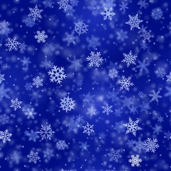 Padrão sem emenda de natal de flocos de neve claros e desfocados complexos em cores azuis com efeito bokeh