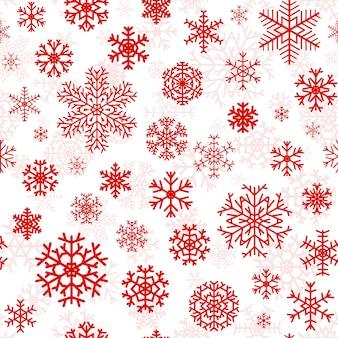 Padrão sem emenda de natal de flocos de neve vermelhos em fundo branco