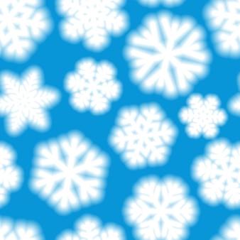 Padrão sem emenda de natal de grandes flocos de neve desfocados, branco sobre fundo azul claro