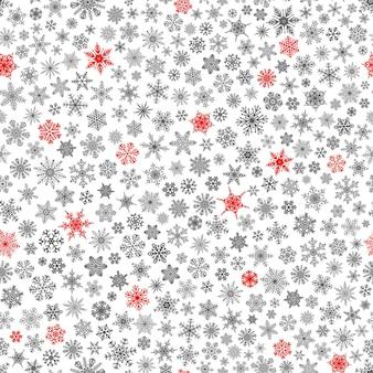 Padrão sem emenda de natal de pequenos flocos de neve, vermelho e preto no branco