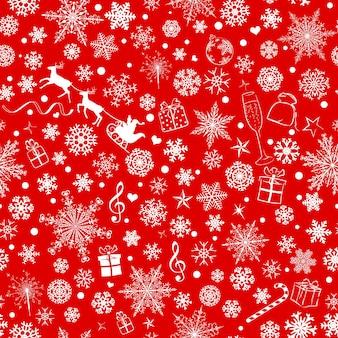 Padrão sem emenda de natal de vários flocos de neve e símbolos de férias, branco sobre fundo vermelho