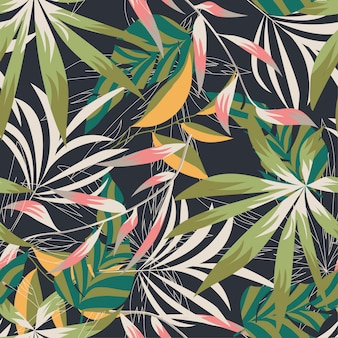 Padrão sem emenda de praia com folhas tropicais coloridas e plantas sobre um fundo delicado