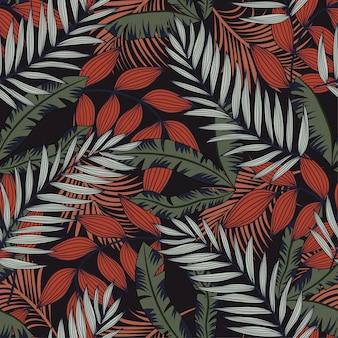 Padrão sem emenda de tendência abstrata com folhas tropicais coloridas e plantas em um fundo escuro