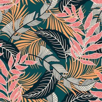 Padrão sem emenda de tendência com folhas tropicais coloridas e plantas sobre fundo verde