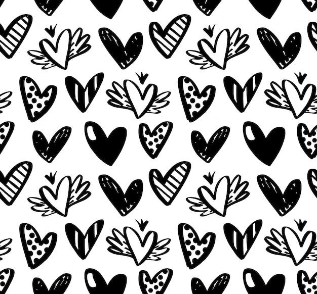 Padrão sem emenda de vetor com mão desenhada corações isoladas no fundo branco.