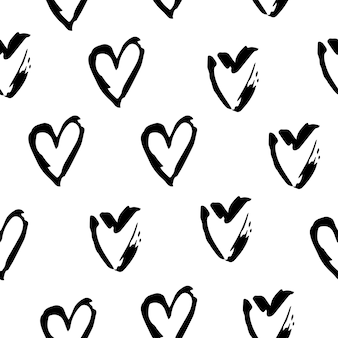 Padrão sem emenda de vetor de corações preto e branco. ilustrações de símbolo de amor à mão livre em fundo branco.