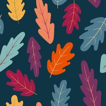 Padrão sem emenda de vetor de outono padrão com folhas coloridas de carvalho em um fundo azul escuro