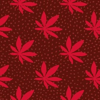 Padrão sem emenda desenhada de mão ganja. fundo marrom com pontos e folhas vermelhas de cannabis.