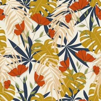 Padrão sem emenda em estilo tropical com plantas coloridas e cores brilhantes. papéis de parede exóticos