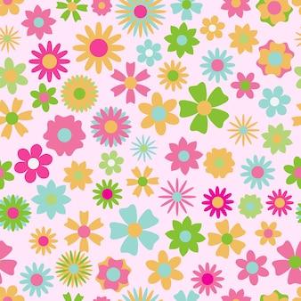 Padrão uniforme de flores em várias cores e formas