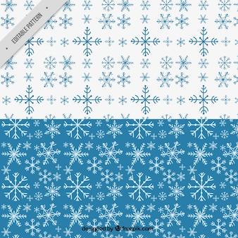 Padrões de azul e branco com flocos de neve