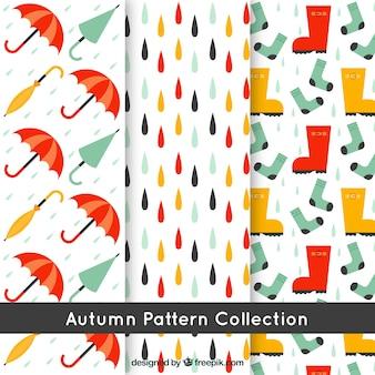 Padrões de outono, guarda-chuvas, botas e chuva
