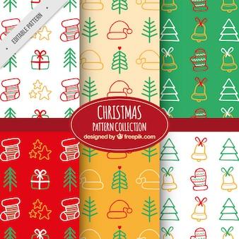 Padrões decorativos com elementos desenhados à mão para o natal