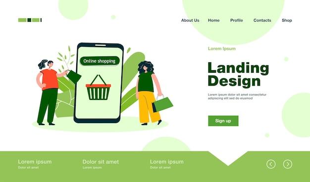 Página de destino on-line de amigos com bolsas comprando roupas em estilo simples
