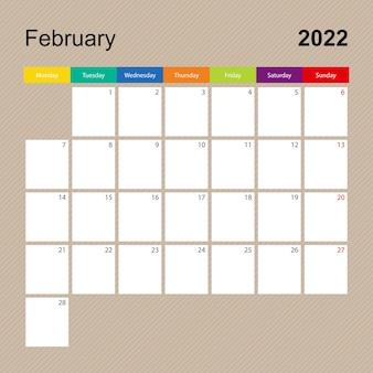 Página do calendário de fevereiro de 2022, planejador de parede com desenho colorido. a semana começa na segunda-feira.