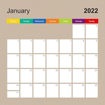 Página do calendário de janeiro de 2022, planejador de parede com desenho colorido. a semana começa na segunda-feira.
