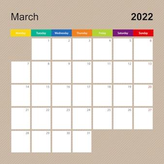 Página do calendário de março de 2022, planejador de parede com desenho colorido. a semana começa na segunda-feira.
