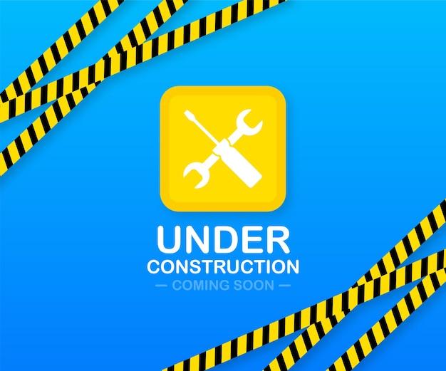 Página do site em construção com bordas listradas em preto e amarelo. teia de faixa de borda