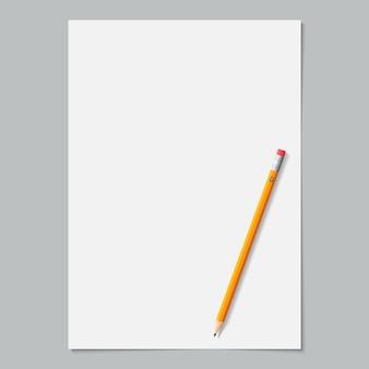Página em branco de papel branco cor com lápis amarelo apontado em cinza.