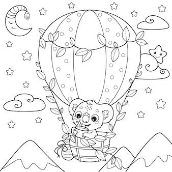Página para colorir de coala bebe chá e voa em um balão de ar quente
