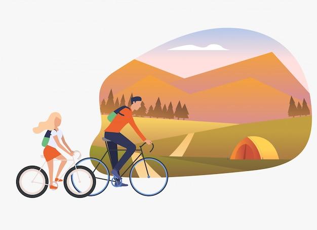 Pai e filha andando de bicicleta, paisagem com tenda