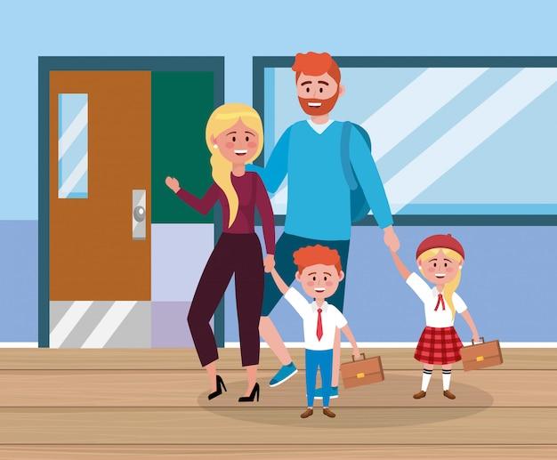 Pai e mãe com sua menina e menino com mala