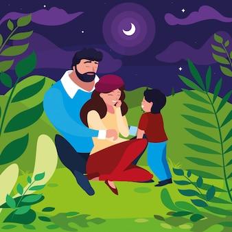 Pais com a família do filho na paisagem noturna