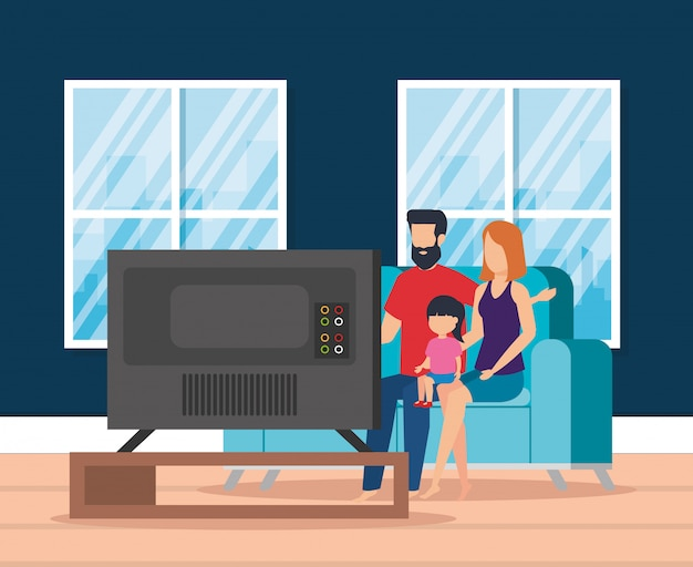 Pais com a filha assistindo televisão