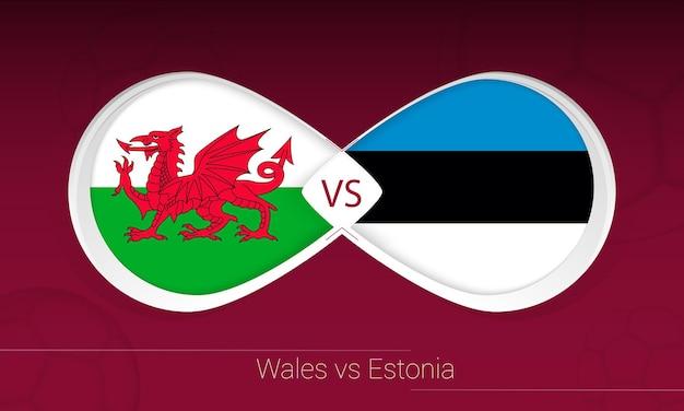 País de gales vs estônia em competição de futebol, ícone do grupo e. versus no fundo do futebol.