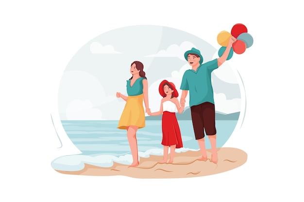 Pais e filha caminhando na praia.