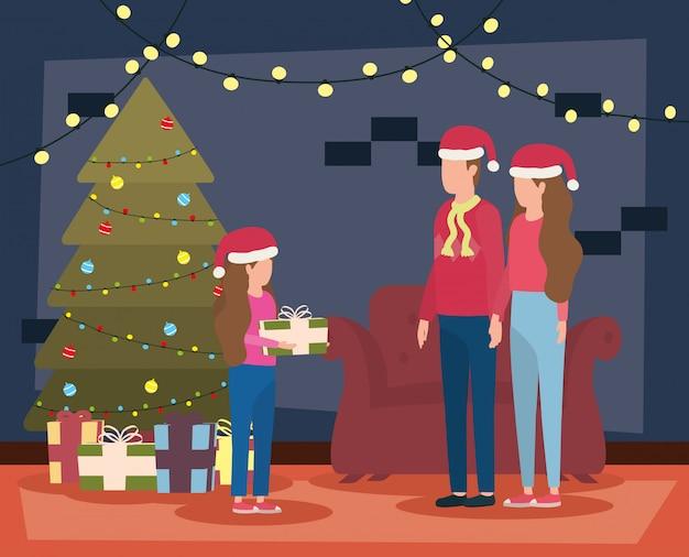 Pais e filha comemorando o natal na sala de estar com árvore