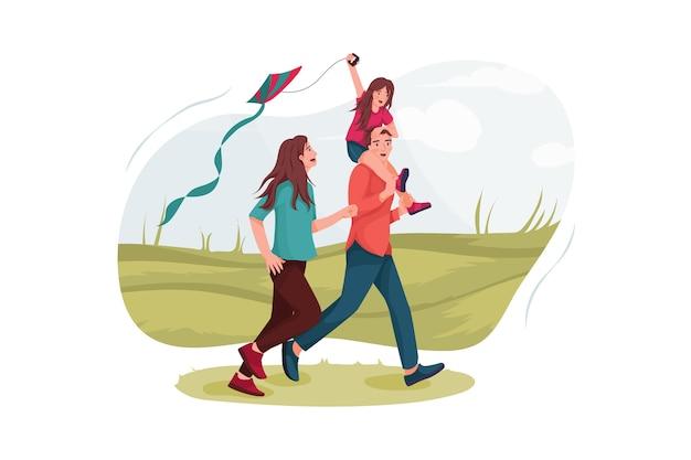 Pais e filha empinando pipas em um prado.