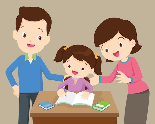 Pais e filha fazendo lição de casa