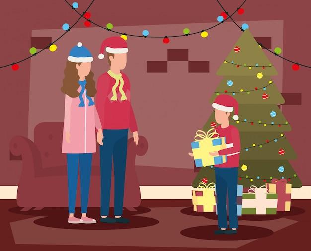 Pais e filho comemorando o natal na sala de estar com árvore