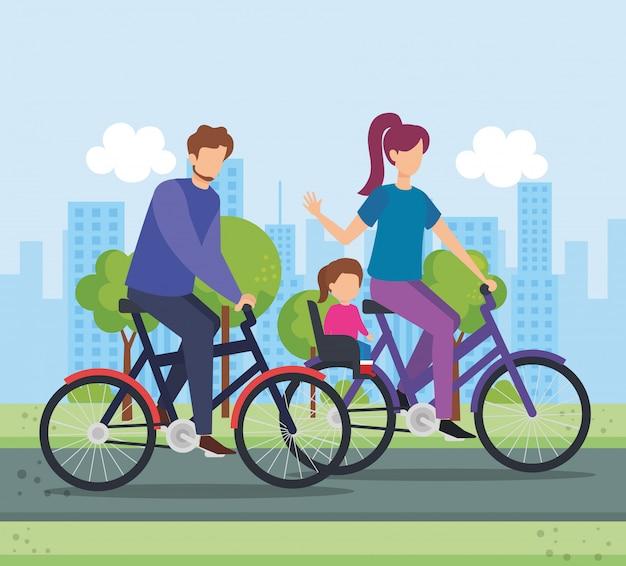 Pais em bicicleta com a filha no parque