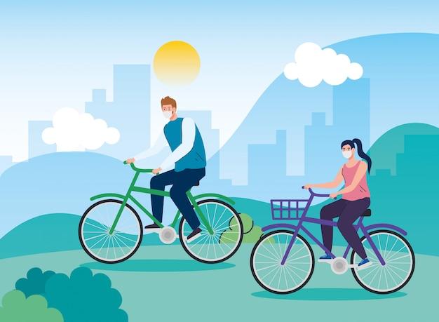 Paisagem com casal usando máscara facial em bicicleta