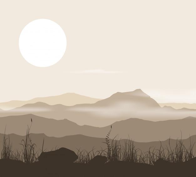 Paisagem com grama e montanhas ao pôr do sol.