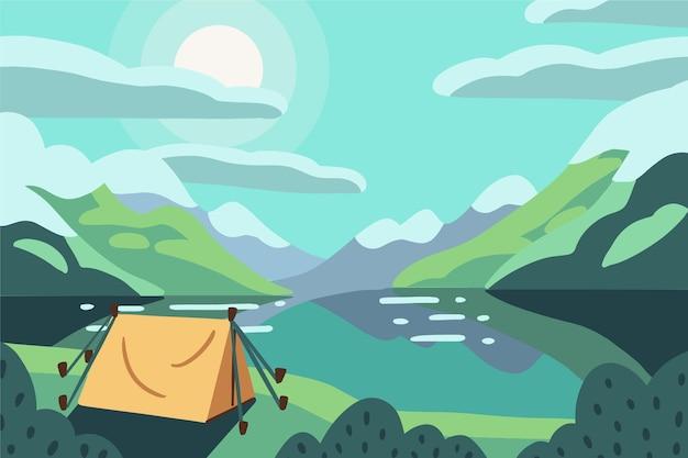 Paisagem da área de acampamento com lago e barraca