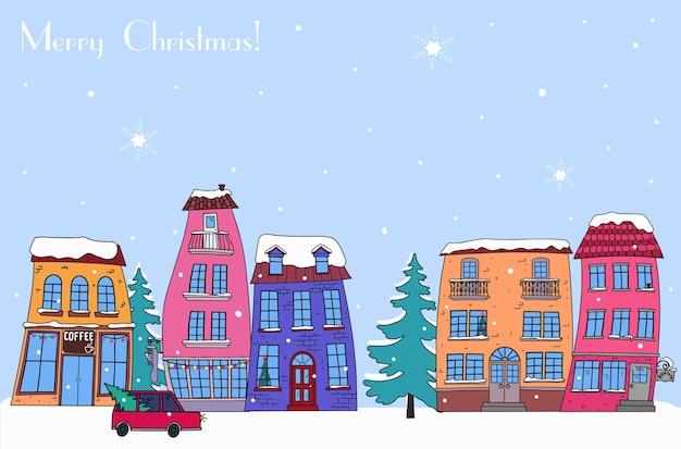 Paisagem da cidade de inverno na véspera de natal. dia de neve, rua com casas decorativas brilhantes.