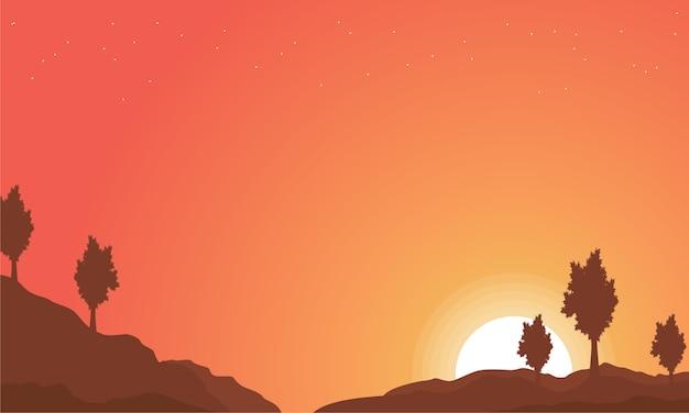 Paisagem de colina com fundos de céu laranja