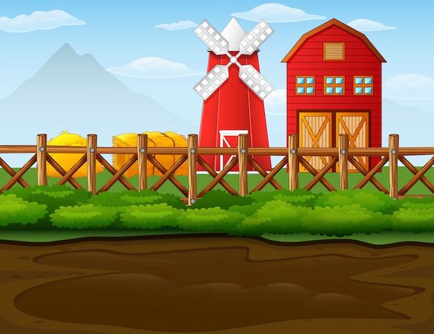 Paisagem de fazenda com galpão e moinho de vento
