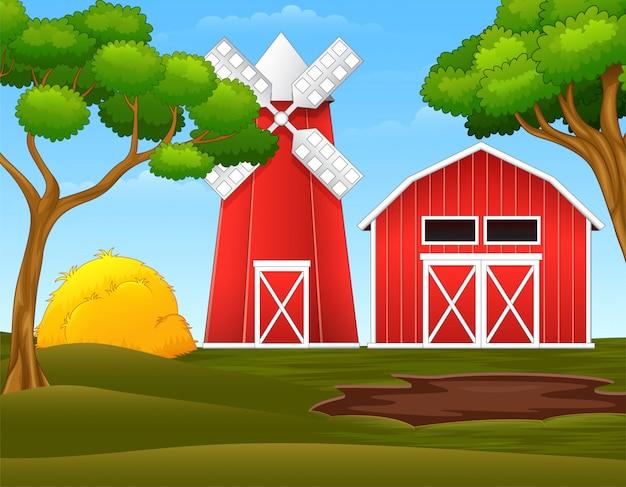 Paisagem de fazenda com galpão vermelho e moinho de vento