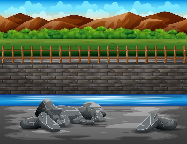 Paisagem de montanha de areia e rio e cerca de madeira