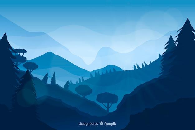 Paisagem de montanhas azuis com árvore do abeto