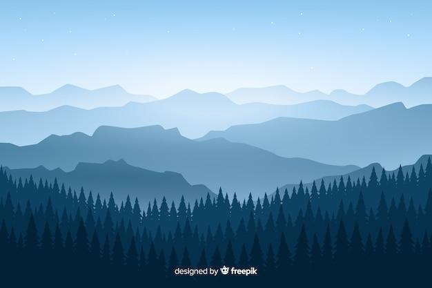 Paisagem de montanhas com árvores em tons de azuis