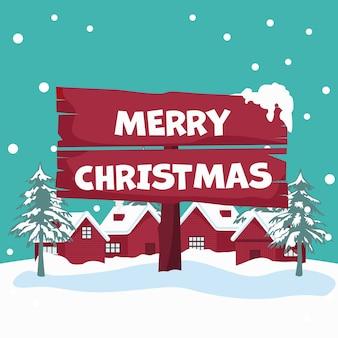 Paisagem de neve com casas segurando cartaz de natal